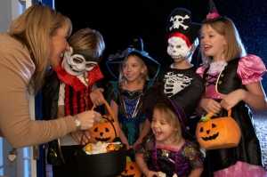 Happy Halloween party with children trick or treating